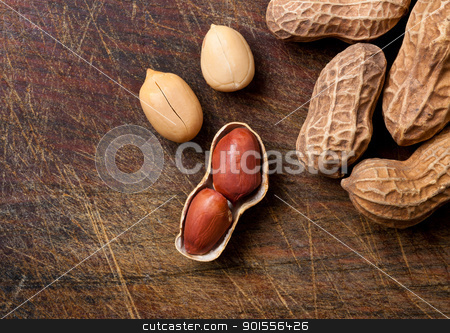 Peanuts on a wooden table. stock photo, Bunch of peanuts on a wooden table. by Pablo Caridad