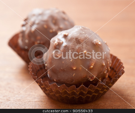 Chocolate sweets  stock photo, Chocolate sweets on  a wood background.  by Pablo Caridad