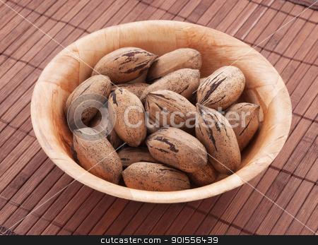 Pecan nuts. stock photo, Bowl of pecan nuts, close up shot.  by Pablo Caridad