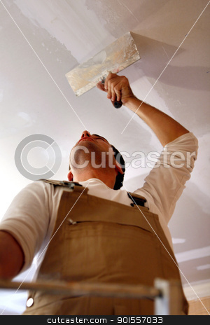 Man putting up a plasterboard ceiling stock photo, Man putting up a plasterboard ceiling by photography33