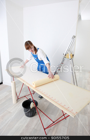 Decorator measuring wall paper stock photo, Decorator measuring wall paper by photography33