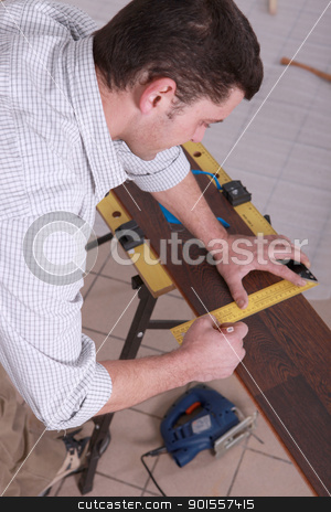 Man measuring wood flooring stock photo, Man measuring wood flooring by photography33