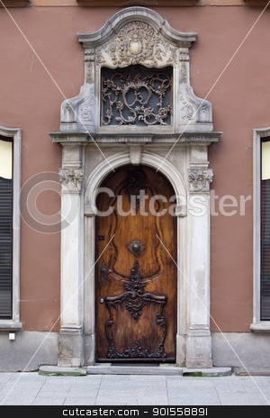 Ornate Door in Gdansk stock photo, Richly decorated antique door on a historic apartment house in the Old Town of Gdansk, Poland by Rognar