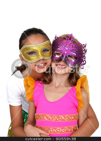 Girls with mask stock photo, Two young girls with color carnival mask by marphotography