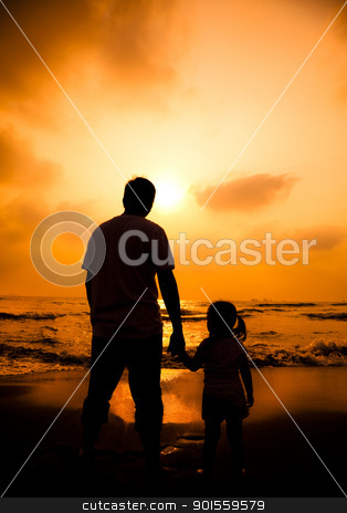 the silhouette of father holding little girl's hand on the beach stock photo, the silhouette of father holding little girl's hand on the beach by tomwang