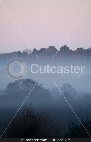 Dawn Mist portrait stock photo, Dawn Mist portrait  with layered horizons and pink glow in sky  by Susan Robinson