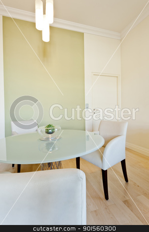 Contemporary table and seating area stock photo, Contemporary table and seating area with a closed door in the background by Ulrich Schade