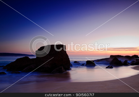 Beach Landscape stock photo, Landscape picture of rocks on the beach at sunset by ikostudio
