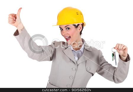 Female architect holding keys stock photo, Female architect holding keys by photography33