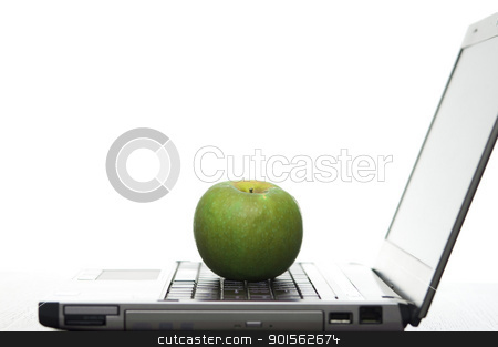 Computer Education stock photo, Open laptop sideways on with a fresh red apple creating a elearning concept. by Stephen Gibson
