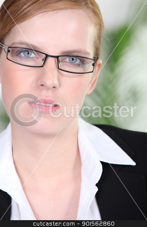 Portrait of a young redhead woman with eyeglasses stock photo, Portrait of a young redhead woman with eyeglasses by photography33