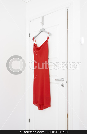 Red Dress stock photo, Red Dress hanging on a door by Anne-Louise Quarfoth