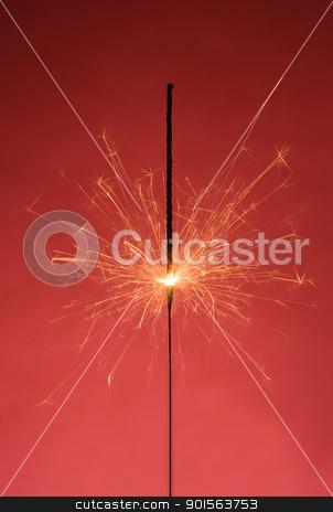 Sparkler stock photo, Burning Sparkler on red background by Anne-Louise Quarfoth
