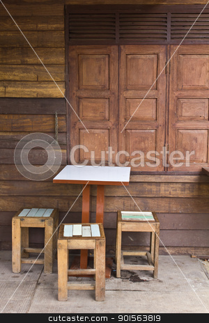 Wooden tables and chairs near the old window stock photo, Wooden tables and chairs near the old window by Lavoview