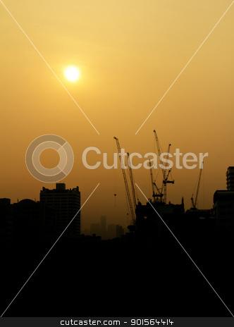 construction at sunrise silhouette stock photo, City under construction at sunrise silhouette by stoonn