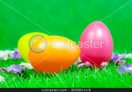 Easter eggs stock photo, Easter eggs on green grass  and green background by VectorImages
