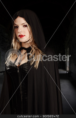 Female vampire in hooded cape stock photo, Photo of a female vampire dressed in leather corset and hooded cape. by © Ron Sumners