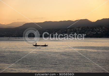 Sunset river mountain stock photo, Boat in lake during sunset. Mountains in the background. by jmffotos