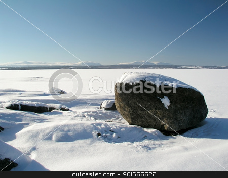 Winter landscape  stock photo, Winter landscape of frozen lake and blue sky by Ingvar Bjork