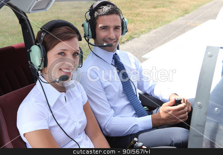 Man and woman in the cockpit of a light aircraft stock photo, Man and woman in the cockpit of a light aircraft by photography33