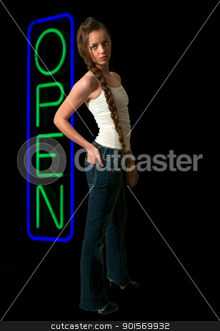 Neon Open Sign stock photo, Beautiful woman standing next to a neon sign letting the world know that an establishment is open. by Robert Byron