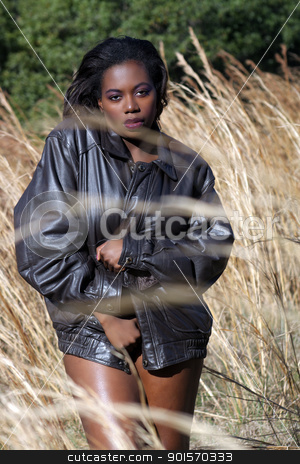 Beautiful Woman Outdoors in Tall Grass (4) stock photo, A lovely young black woman outdoors, standing in tall grass. by Carl Stewart