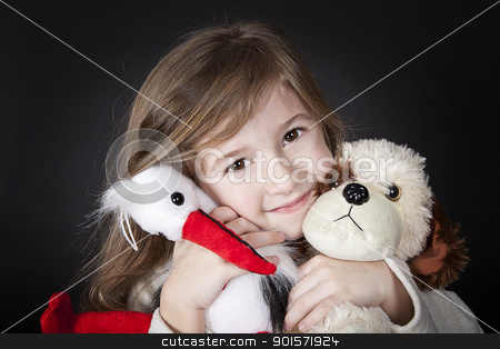 happy girl with her toy friends stock photo, smiling girl hugging toy stork and dog by photomim