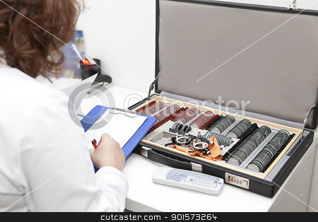 optometrist preparing diagnosis stock photo, a woman optometrist and the suitcase with sight testing set by photomim