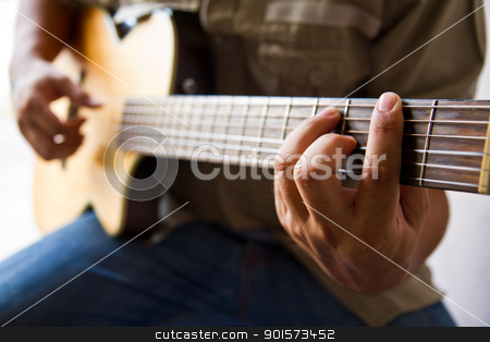 Playing guitar F# chord stock photo