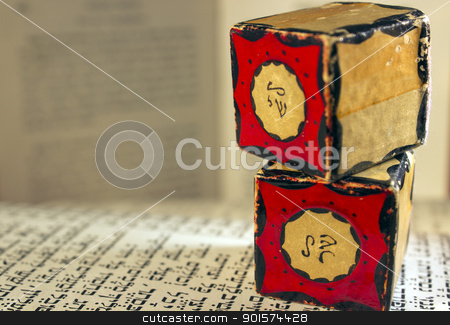Tefillin Amulets Close Up stock photo, Two tefillin amulets sitting on a prayer book. by Jadthree