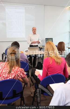 Teacher stood at front of class room stock photo, Teacher stood at front of class room by photography33