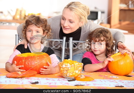 Family carving pumpkins together stock photo, Family carving pumpkins together by photography33