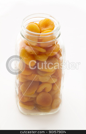 apricot in a jar stock photo, dried apricot in a glass jar by Yann Poirier