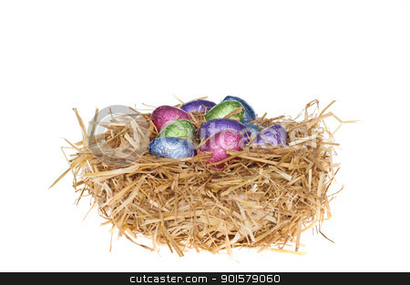 Straw nest with chocolate Easter eggs stock photo, Straw nest with chocolate Easter eggs over white studio shoot by Ulrich Schade
