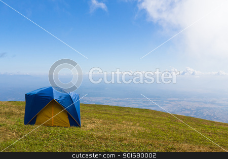 Tent on a grass under  blue sky stock photo, Tent on a grass under white clouds and blue sky by stoonn