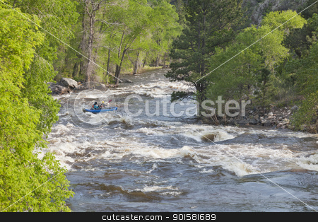 Springtime whitewater in  Colorado stock photo, Springtime whitewater of Cache la Poudre River near Fort Collins, Colorado with a kayak in the middle of a rapid by Marek Uliasz
