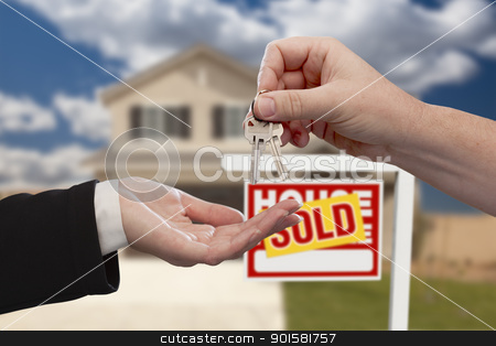 Handing Over the House Keys in Front of Sold New Home stock photo, Handing Over the House Keys in Front of Real Estate Sign and Sold New Home. by Andy Dean