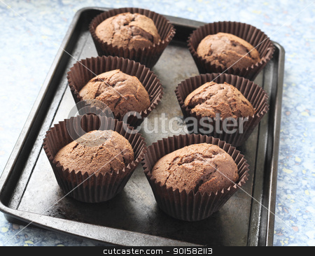 Freshly baked chocolate cupcakes stock photo, Home made chocolate cupcakes straight from the oven, on a metal tray. by Dawn Norfolk