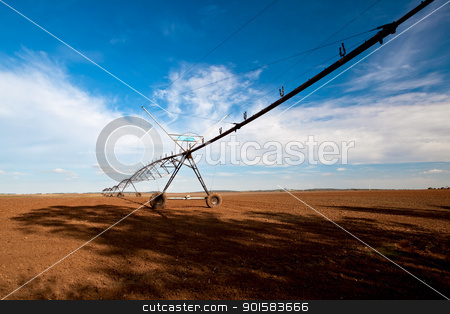 Agriculture farm stock photo, Agriculture farm being irrigated by industrials mechanisms by ikostudio