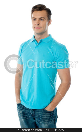 Portrait of a casual young man stock photo, Casual young man standing with his hands in his pocket against white background by Ishay Botbol