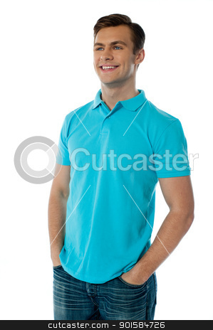 Handsome young guy, relaxed and smiling stock photo, Relaxed handsome young guy looking away while posing with hands in his pocket by Ishay Botbol