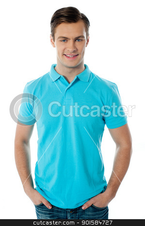Portrait of a handsome man stock photo, Portrait of a handsome man posing with arms in the pocket by Ishay Botbol