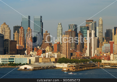 Urban city sunset stock photo, Urban city sunset. New York City Manhattan skyline at sunset with skyscrapers over Hudson river. by rabbit75_cut