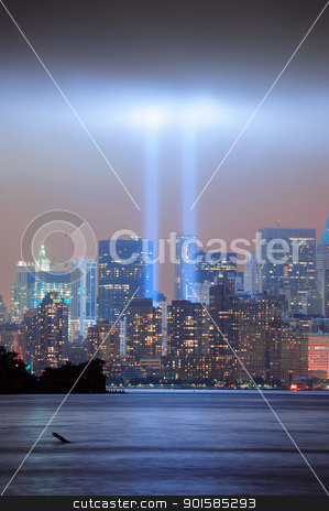New York City night stock photo, New York City Manhattan downtown skyline at night from Liberty Park with light beams in memory of September 11 viewed from New Jersey waterfront. by rabbit75_cut