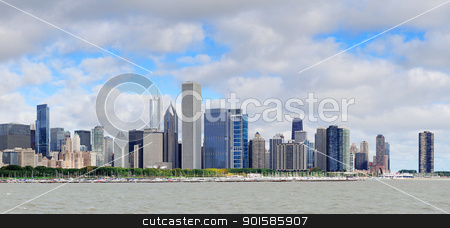 Chicago skyline panorama stock photo, Chicago skyline panorama with skyscrapers over Lake Michigan with cloudy blue sky. by rabbit75_cut