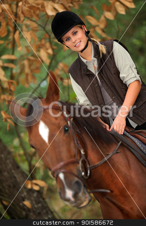 Young girl horseriding through the forest stock photo, Young girl horseriding through the forest by photography33