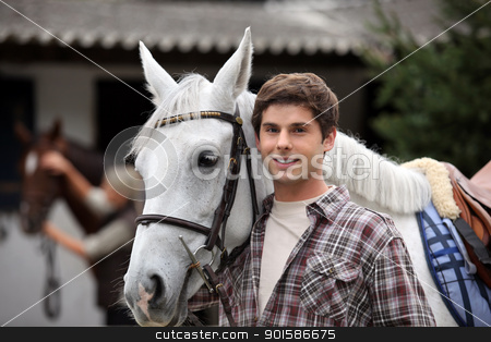 portrait of a young man with horse stock photo, portrait of a young man with horse by photography33