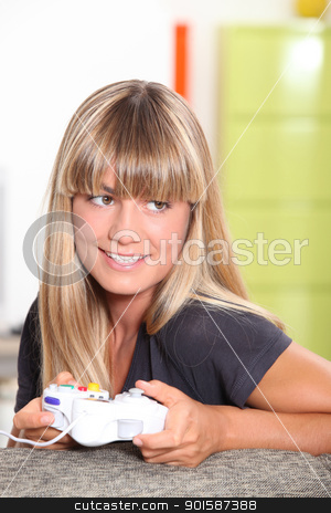 Girl playing on games console stock photo, Girl playing on games console by photography33