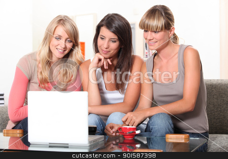 Young women watching a film on a laptop stock photo, Young women watching a film on a laptop by photography33