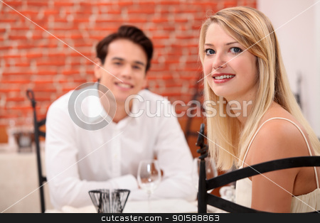 Young couple on a date in a restaurant stock photo, Young couple on a date in a restaurant by photography33
